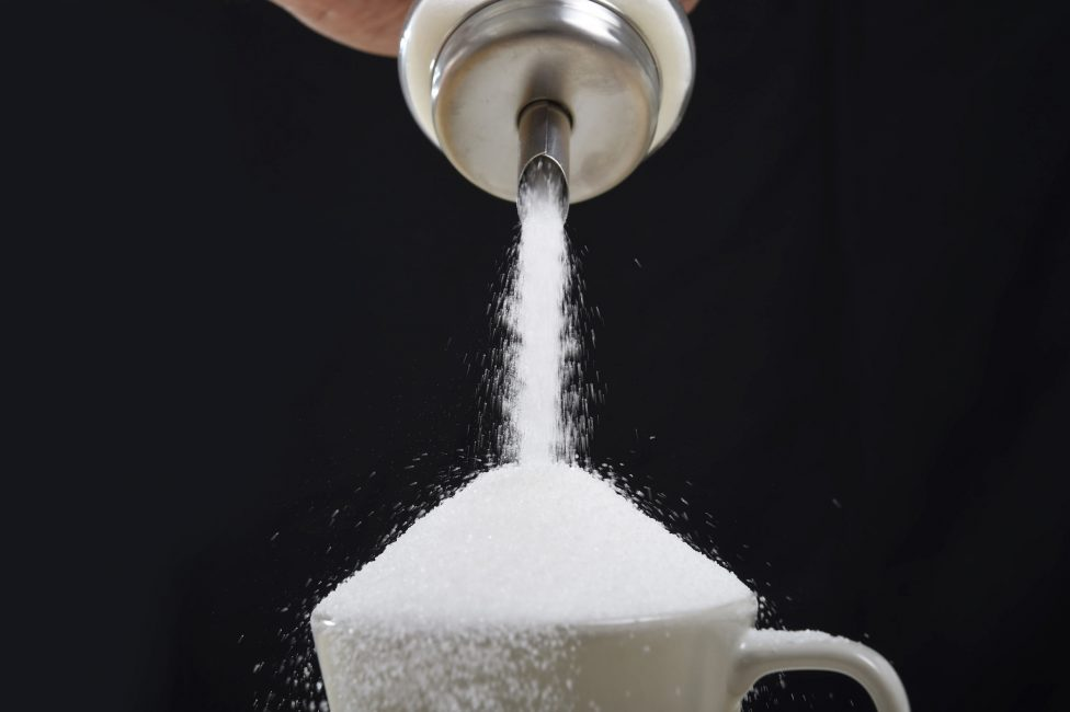 sugar pouring into cup