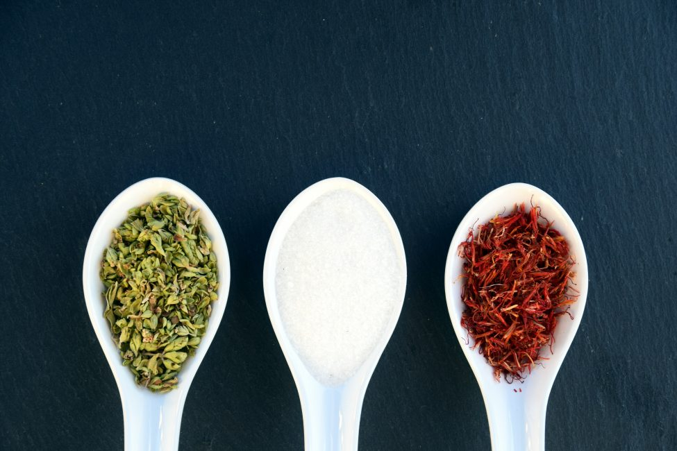 three different spices in tablespoons