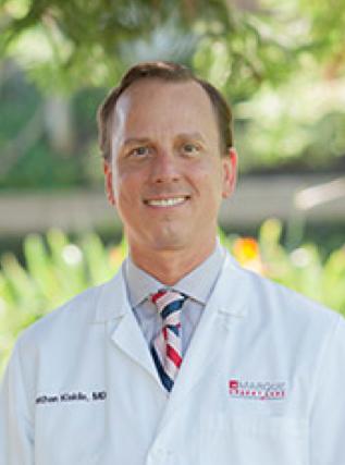 Head shot of Nathan Kiskila, M.D. at Marque Medical