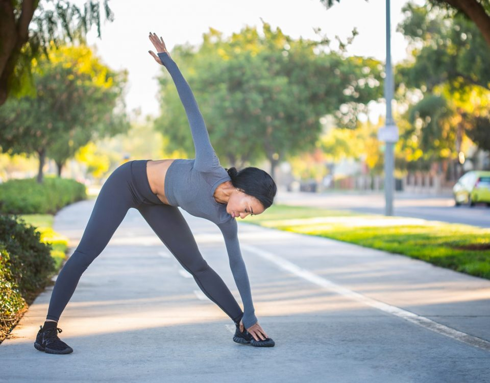 woman stretching after her running warm up