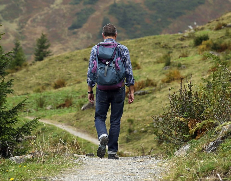 middle aged man enjoying mountain hike