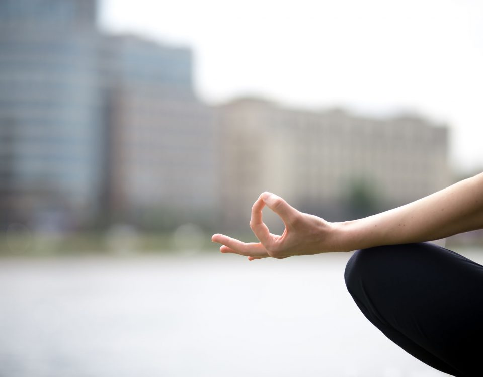 hand resting on knee in meditation pose
